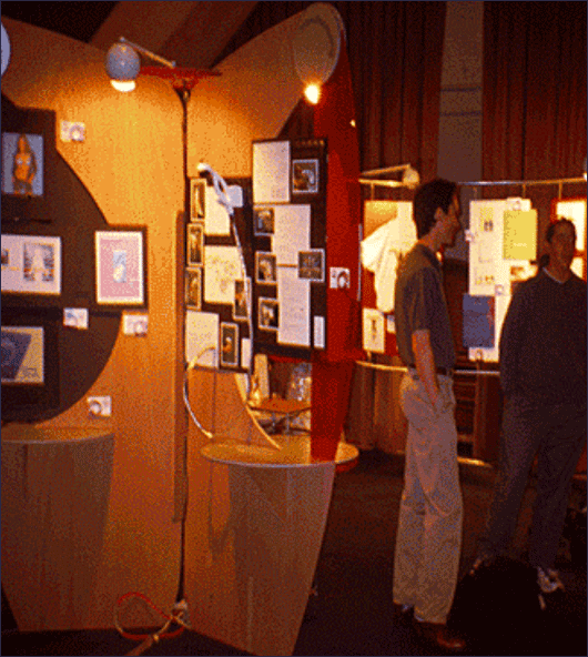 People viewing graphic design exhibit